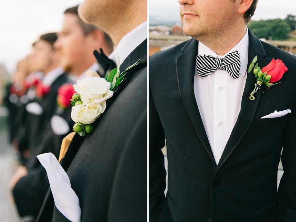 groomsmen with roses