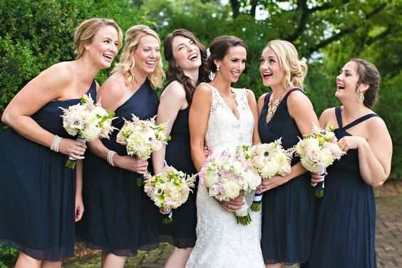 Bridesmaids in navy with vintage bouquets