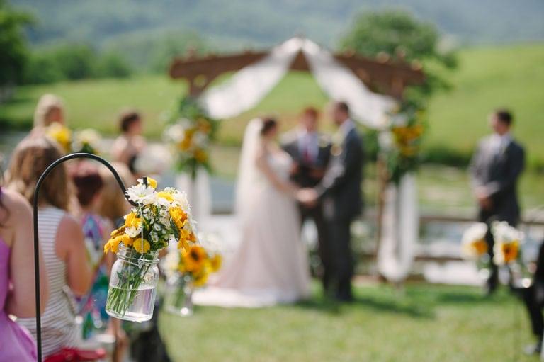 Sunflowers wedding aisle flowers on shepherd hooks