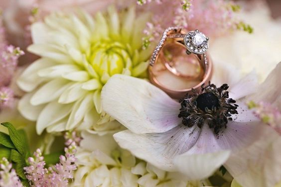 Rose Gold wedding bands on bridesmaids bouquet