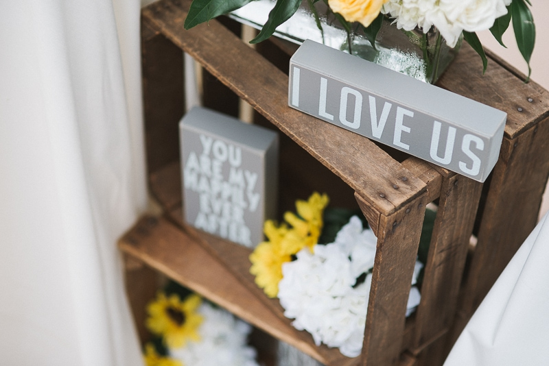 Apple boxes filled with sunflowers and love notes at ceremony