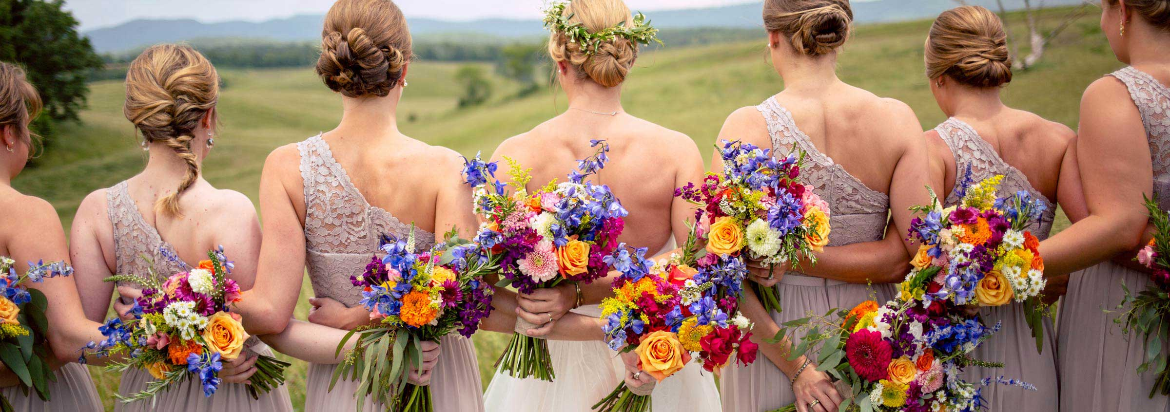 Colorful wedding flower bouquets for the bride and bridesmaids at an outdoor wedding